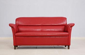 Canapea rosie fixa de doua locuri