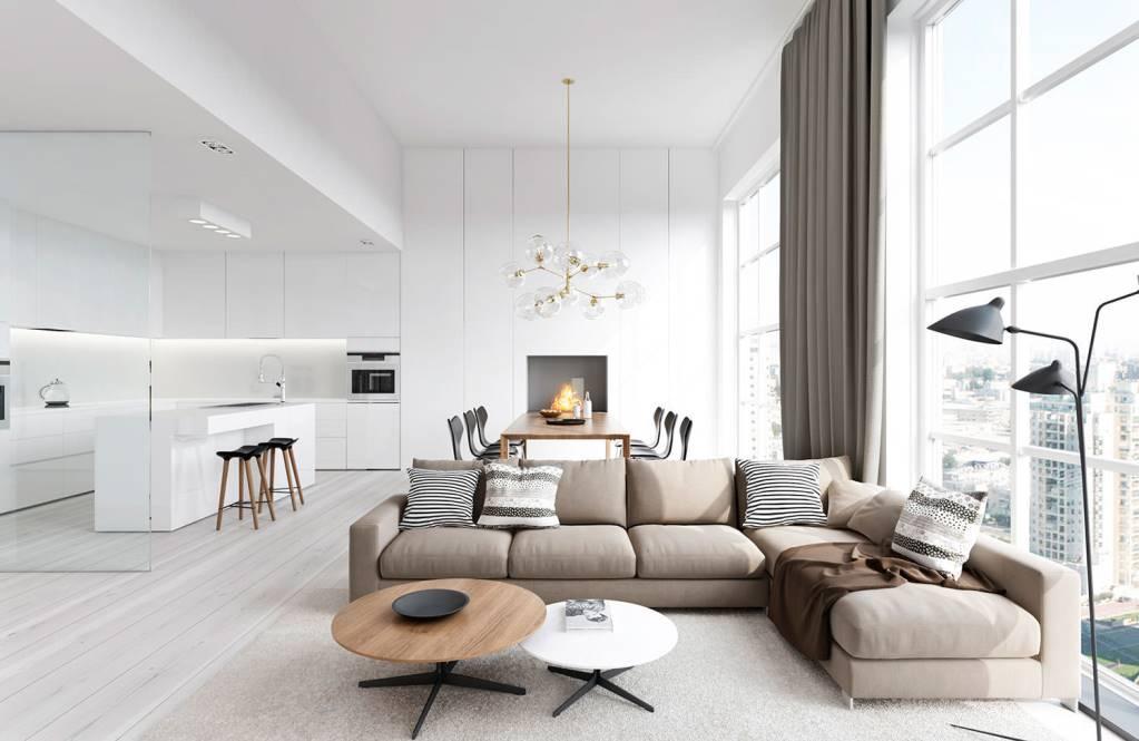 Canapea de colt bej si masa rotunda din lemn in living openspace alb cu draperii maro