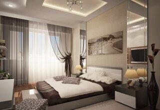 Dormitor bej cu accente albe si maro inchis