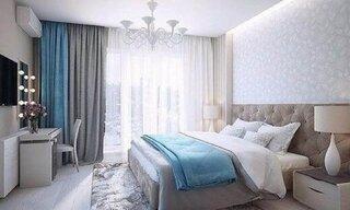 Dormitor gri cu accente turcoaz