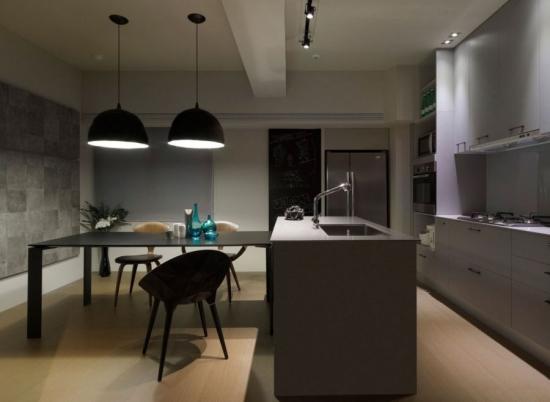 Amenajare minimalista pentru o bucatarie gri