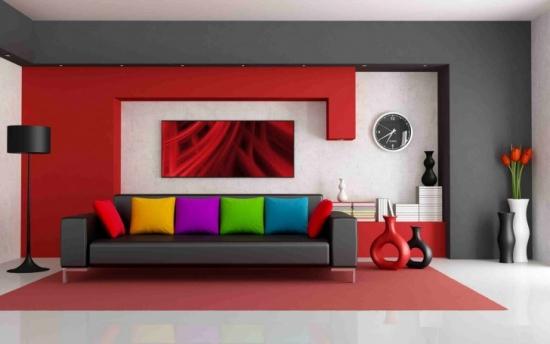 Perete de accent in spatele canapelei cu forme din rigips vopsit in rosu