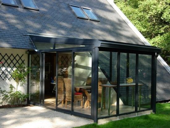 Veranda in prelungirea casei cu acoperis plat