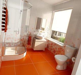 Baie cu faianta alba cu flori portocalii si gresie portocalie simpla cu cabina de dus pe colt