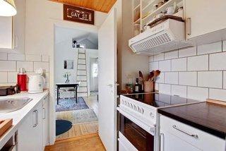 Bucatarie casa mica din lemn