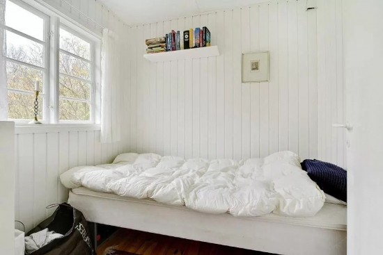 Dormitor casa mica din lemn