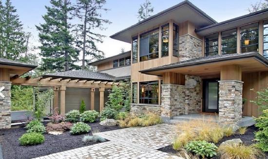 Casa in stil modern placata cu piatra la interior si la for Casa moderna exterior
