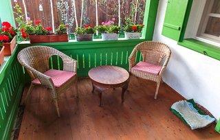 Veranda casa traditionala cu fotolii