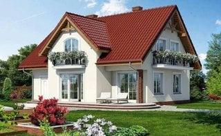 Casa cu fatada alba si garaj lateral