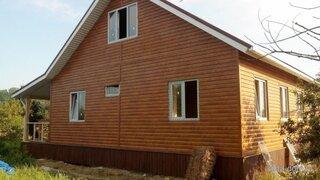 Casa placata cu lambriu din lemn