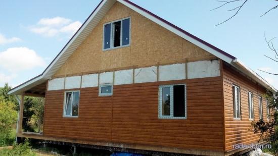 Casa placata cu siding din lemn