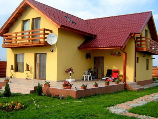 Casa cu mansarda in forma de L