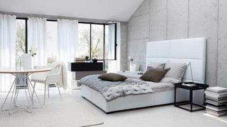 Dormitor amenajat cu gri alb si crem