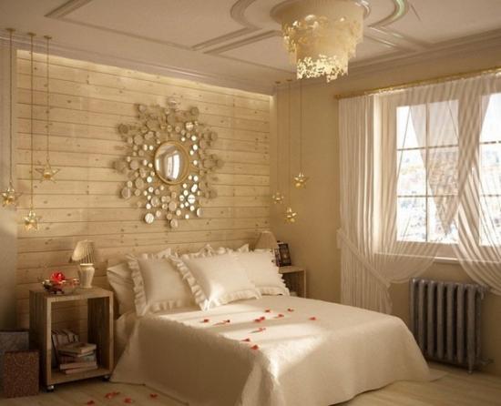 Dormitor cu pat alb si peretii placati cu lambriu din lemn pentru un stil rustic