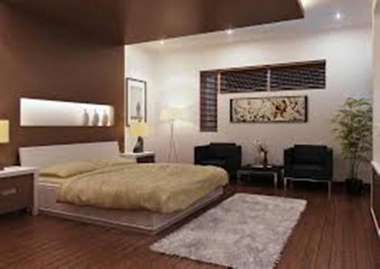 Dormitor uimitor amenajat cu alb si maro ciocolata