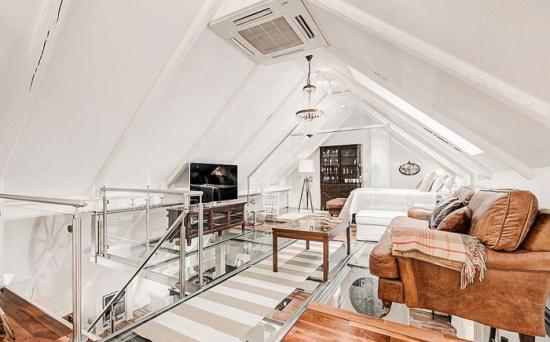 Amenajarea unui living in stil nordic la mansada cu TV