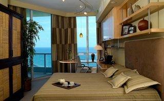 Camera cu birou si dormitor amenajata in stil asiatic