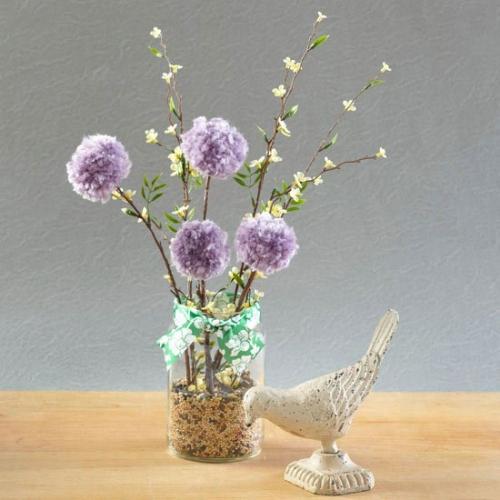 Borcan cu seminte de mei si in cu flori mov