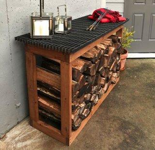 Masa de exterior cu spatiu pentru lemnele de foc