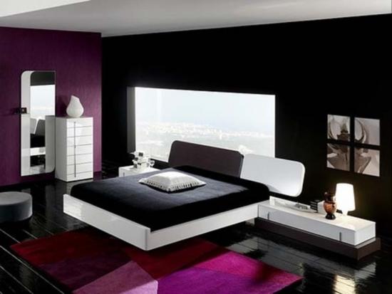 Dormitor amenajat in stil contemporan cu peretii negri si mobila alba
