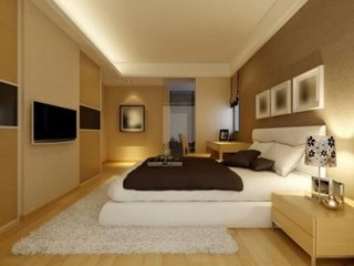 Amenajare dormitor cu mobila din lemn si pat alb