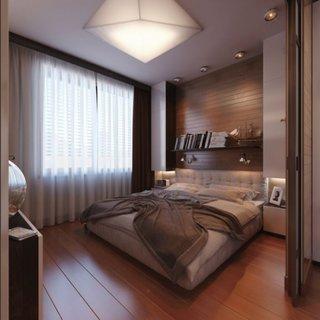 Dormitor cu dusumea pe jos si peretele de accent placat cu lemn