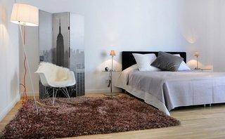 Paravan decorativ intr-un dormitor scandinav