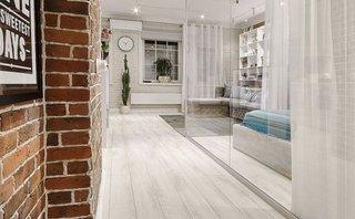 Dusumea alb gri si pereti albi din caramida pentru un decor scandinav modern