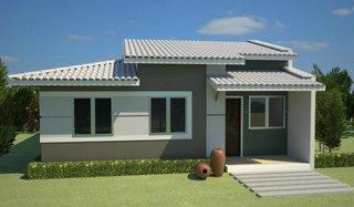 Casa mica moderna cu fatada gri cu alb gradina verde