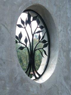 Grilaj decorativ fereastra rotunda