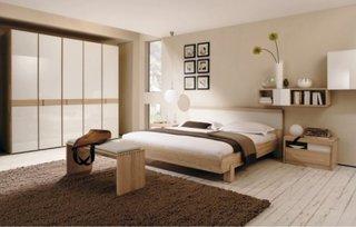 Dormitor amenajat minimalist in nuante neutre