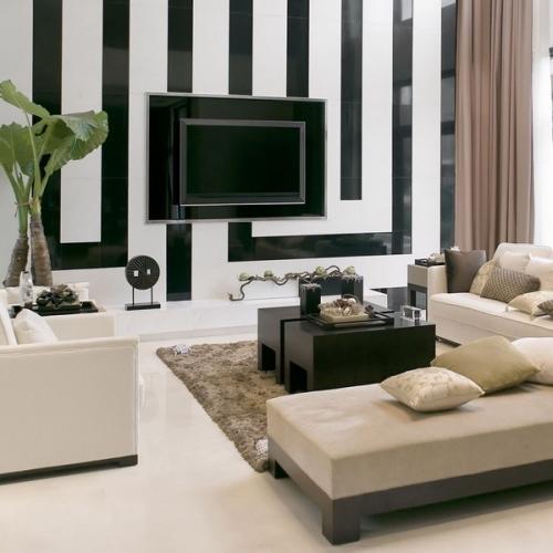 Living minimalist in nuante neutre si perete de accent negru cu alb