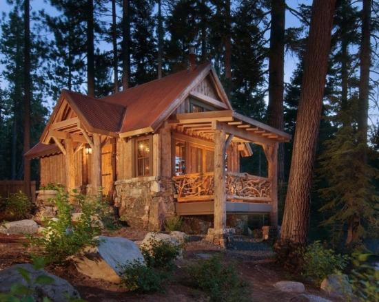 Cabana din busteni cu balustrada executata din crengi