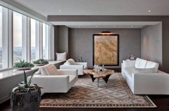 Camera de zi cu covor mare model persan si doua canapele albe