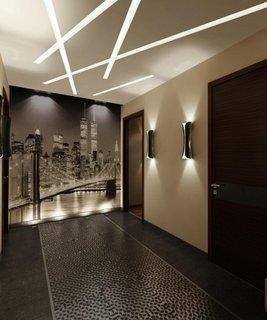 Hol decorat in alb si negru si lumini pe tavan si pereti