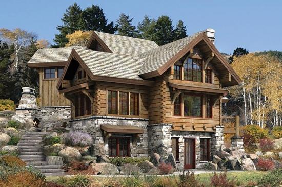 Casa cu parter placat cu piatra si etaj din lemn