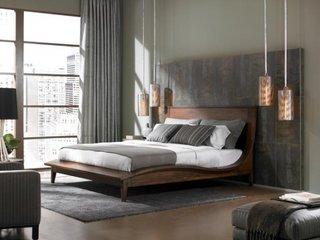 Dormitor in stil urban modern cu corpuri de iluminat suspendate langa pat