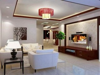 Living clasic cu tavan fals si accente din lemn