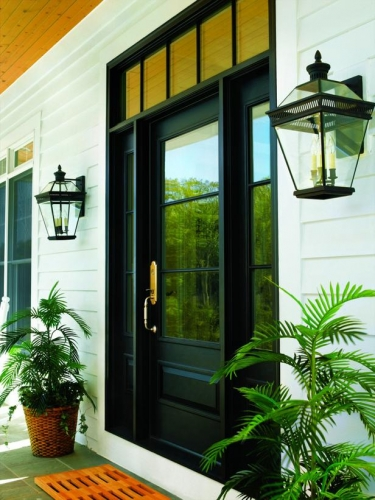 Usa exterioara dubla neagra cu geamuri asoratata la fatada alba