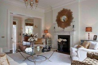 Combinatie eleganta de alb si auriu in amenajare