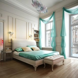 Dormitor amenajat cu alb si perdele semitransparente turcoaz
