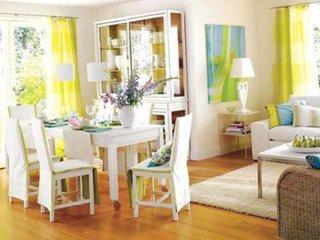 Dinning open space cu livingul amenajat in alb si perdele verzi