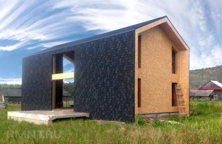 Casa moderna placata cu sindrila
