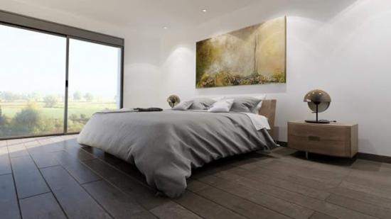 Dormitor spatios cu decor alb
