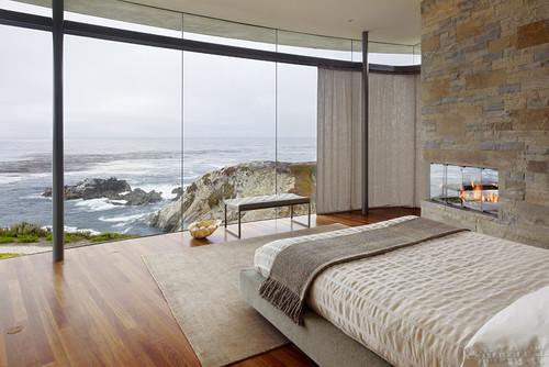 dormitor modern cu perete din piatra