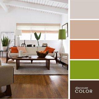 Living minimalist in tonuri de bej si accente oranj si verde crud
