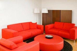 Set de canapele fixe din piele rosie si picioare cromate
