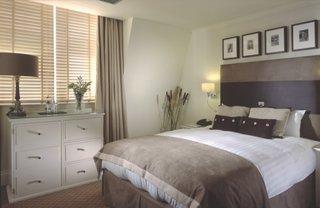 Dormitor cu tonuri neutre