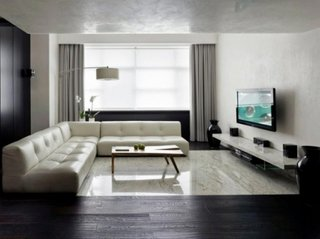 Pardoseala in living combinatie de marmura cu parchet din lemn negru