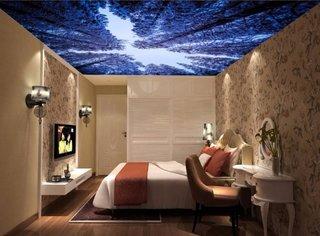 Dormitor amenajat cu tapet